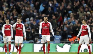 Arsenal's Pierre-Emerick Aubameyang, center, reacts after Manchester City scored their second goal during the English League Cup final soccer match between Arsenal and Manchester City at Wembley stadium in London, Sunday, Feb. 25, 2018. (AP Photo/Frank Augstein)