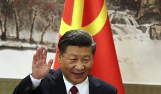 FILE - In this Oct. 25, 2017, file photo, Chinese President Xi Jinping waves while addressing the media as he introduced new members of the Politburo Standing Committee at Beijing's Great Hall of the People. China's official news agency said Sunday, Feb. 25, 2018, the ruling Communist Party proposed removing a limit of two consecutive terms for the country's president and vice president. The move, if approved, appears to lay the groundwork for party leader Xi to rule as president beyond 2023. (AP Photo/Ng Han Guan, File)