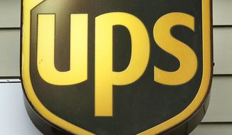 FILE - A Wednesday, April 12, 2017, file photo, showing a UPS logo on the exterior of The UPS Store, in Natick, Mass. U.S. delivery giant UPS has launched court action against the European Union's anti-trust regulator for blocking a merger with Dutch firm TNT and is seeking 1.742 billion euros ($2.14 billion) in compensation. (AP Photo/Steven Senne, File)