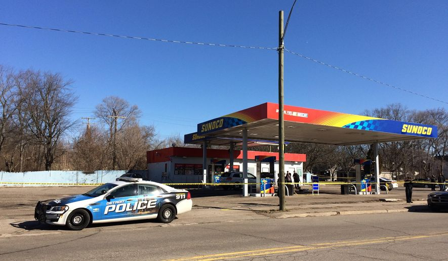 Two women and two men are dead after two shootings at a Sunoco gas station and in a nearby neighborhood on Detroit's west side, Monday, Feb. 26, 2018, police say. Police believe the shootings are connected. The first happened at about 8:40 a.m. Monday at the gas station on the corner of Fenkell and Beaverland near Telegraph. Jacqueline Pritchett, a commander of the Detroit Police Department's 8th Precinct, said investigators have identified the suspect and three of the victims.  (Charlie E. Ramirez/Detroit News via AP)