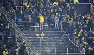 Dortmund's Ultras supporters on the famous South Tribune boycott the German Bundesliga soccer match between Borussia Dortmund and FC Augsburg in Dortmund, Germany, Monday, Feb 26, 2018. Thousands of supporters protest against Bundesliga matches on Mondays. (AP Photo/Martin Meissner)