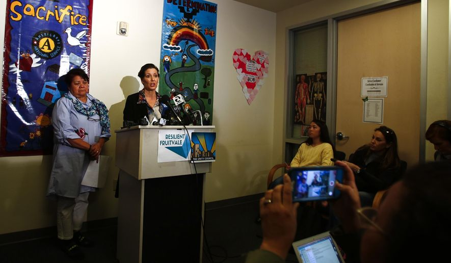 In this Sunday Feb. 25, 2018 photo, Oakland Mayor Libby Schaaf holds a press conference to address potential Immigration and Customs Enforcement activity in the area at Fruitvale Village in Oakland, Calif. In an unprecedented warning this weekend, Schaaf alerted residents of large-scale raids by ICE agents in the San Francisco Bay Area within 24 hours. Major arrests have not materialized, but Schaaf's message comes after months of criticism following her administration's decision to allow Oakland police to work with ICE agents on a raid, violating city policies. (Randy Vazquez/ Bay Area News Group via AP)