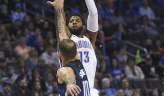 Oklahoma City Thunder's Paul George (13) shoots over Orlando Magic's Evan Fournier (10) in the second half of an NBA basketball game in Oklahoma City, Monday, Feb. 26, 2018. (AP Photo/Kyle Phillips)