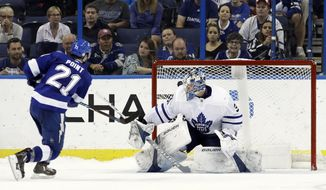 Tampa Bay Lightning center Brayden Point (21) beats Toronto Maple Leafs goaltender Frederik Andersen (31) for a goal during a shootout in an NHL hockey game Monday, Feb. 26, 2018, in Tampa, Fla. (AP Photo/Chris O'Meara)