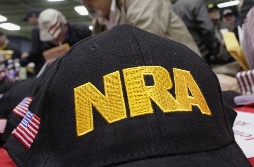 In this March 7, 2012, file photo, Illinois gun owners and supporters file out National Rifle Association applications while participating in an Illinois Gun Owners Lobby Day convention before marching to the Illinois state Capitol in Springfield, Ill. (AP Photo/Seth Perlman, File)