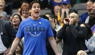 Dallas Mavericks owner Mark Cuban, left, reacts as his team plays the Indiana Pacers during the second half of an NBA basketball game, Monday, Feb. 26, 2018, in Dallas. (AP Photo/Ron Jenkins)  **FILE**