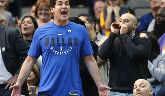 Dallas Mavericks owner Mark Cuban, left, reacts as his team plays the Indiana Pacers during the second half of an NBA basketball game, Monday, Feb. 26, 2018, in Dallas. (AP Photo/Ron Jenkins)