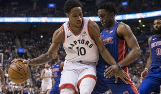 Toronto Raptors' DeMar DeRozan (left) shields the ball from Detroit Pistons' Stanley Johnson during first-half NBA basketball game action in Toronto, Monday, Feb. 26, 2018. (Chris Young/The Canadian Press via AP)