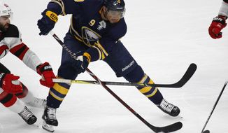 FILE - In this Jan. 30, 2018, file photo, Buffalo Sabres forward Evander Kane (9) controls the puck during the third period of an NHL hockey game against the New Jersey Devils in Buffalo, N.Y. The San Jose Sharks have acquired Kane from the Sabres in a move to upgrade their depleted forward group. (AP Photo/Jeffrey T. Barnes, File)