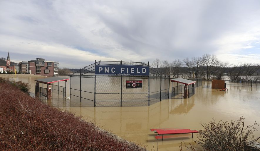 PNC Field is seen under water at the Le Blond Community Center in the East End, Sunday, Feb. 25, 2018. Heavy rains overnight have sent the swollen Ohio River to its highest point in 20 years with the river expected to remain above flood stage through the end of the week, a National Weather Service meteorologist said Sunday. (Kareem Elgazzar/The Cincinnati Enquirer via AP)