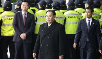 Kim Yong Chol, center, vice chairman of North Korea's ruling Workers' Party Central Committee, leaves to return to North Korea, at a hotel in Seoul, South Korea, Tuesday, Feb. 27, 2018. The North Korean envoy making a rare visit to South Korea said Sunday that his country was willing to open talks with the United States, a rare step toward diplomacy between enemies after a year of North Korean missile and nuclear tests and direct threats of war from both Pyongyang and Washington. (AP Photo/Ahn Young-joon)