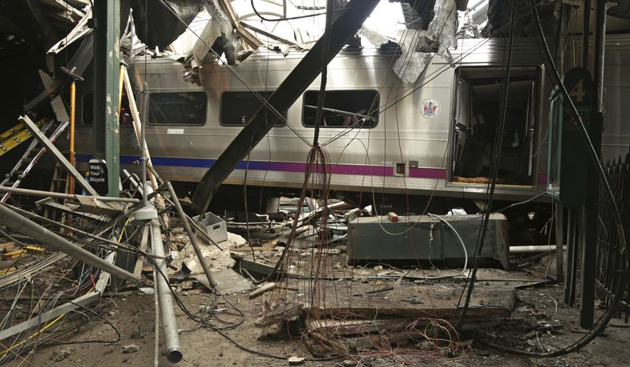 FILE - This Oct. 1, 2016, file photo, provided by the National Transportation Safety Board shows damage done to the Hoboken Terminal in Hoboken, N.J., after a commuter train crash. President Donald Trump is putting the brakes on attempts to address dangerous transportation safety problems from speeding tractor-trailers to sleepy railroad engineers as part of his quest to roll back regulations across the government.(Chris O'Neil/NTSB photo via AP, File)
