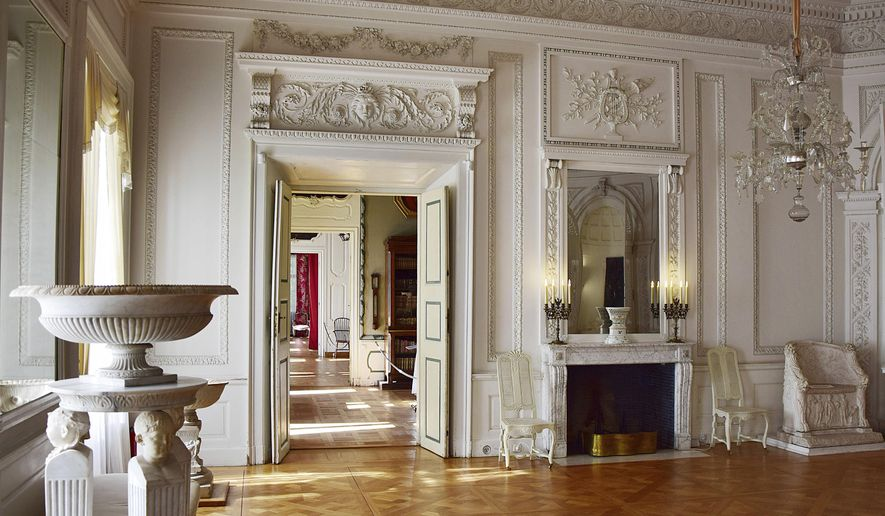 The Oct. 1, 2017 photo shows the White Room, which also served as the ballroom, of the early classicist Nieborow Palace in central Poland. Lee Radziwill, sister-in-law of John F. Kennedy, was married to the son of Prince Janusz Radziwill, the palace's last owner before it was seized. (AP Photo/Piotr Sakowicz)