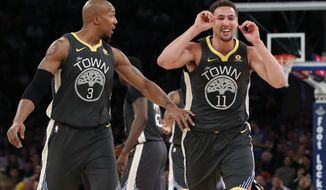 Golden State Warriors forward David West (3) and guard Klay Thompson (11) react toward their bench during the second half of an NBA basketball game against the New York Knicks, Monday, Feb. 26, 2018, in New York. (AP Photo/Kathy Willens)