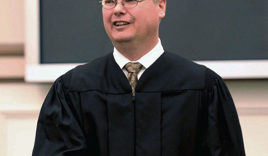 FILE - This 2016 file photo shows Sauk County Circuit Court Judge Michael Screnock, a candidate for the Wisconsin Supreme Court. Screnock refuses to release a letter he sent to the National Rifle Association that resulted in winning the group's endorsement. His opponent Rebecca Dallet is now making the NRA's support of Screnock a key part of her campaign against him for a 10-year seat on Wisconsin's highest court. (Tim Damos/Baraboo News Republic via AP, File)
