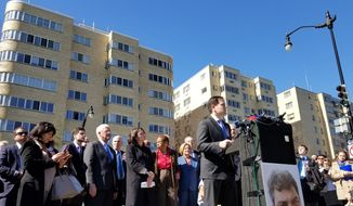Flanked by members of the D.C. Council, Sen. Marco Rubio addresses a gathering to dedicate Boris Nemtsov Plaza in front of the Russian Embassy on Tuesday. Mr. Rubio was instrumental in getting the area renamed after the Russian opposition leader who was assassinated near the Kremlin in 2015. (Julia Airey /The Washington Times)