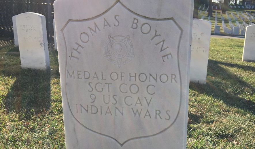 Sgt. Thomas Boyne's headstone bears an inlaid shield showing that he served in Civil War-era campaigns and earned the Medal of Honor distinction in the Indian Wars. (Laura Kelly/The Washington Times)