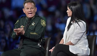 Broward Sheriff Scott Israel makes a point to NRA Spokesperson Dana Loesch during a CNN town hall meeting, Wednesday, Feb. 21, 2018, at the BB&T Center, in Sunrise, Fla. (Michael Laughlin/South Florida Sun-Sentinel via AP)