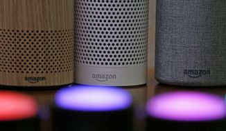 In this Sept. 27, 2017, file photo, Amazon Echo and Echo Plus devices, behind, sit near illuminated Echo Button devices during an event announcing several new Amazon products by the company in Seattle.  Amazon is expanding its home-security business by buying Ring, the maker of Wi-Fi-connected doorbells. The deal comes months after the online retailer started selling its own Wi-Fi-connected indoor security cameras, which work with its voice-assistant Alexa. (AP Photo/Elaine Thompson, File)