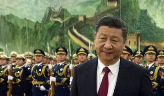 In this Tuesday, Jan. 9, 2018, file photo, Chinese President Xi Jinping reviews a Chinese honor guard during a welcome ceremony for a visiting dignitary at the Great Hall of the People in Beijing. In a rare public expression of dissent in China, a well-known political commentator and a prominent businesswoman penned open letters urging lawmakers to reject a plan that would allow President Xi Jinping to rule indefinitely. (AP Photo/Mark Schiefelbein, File)