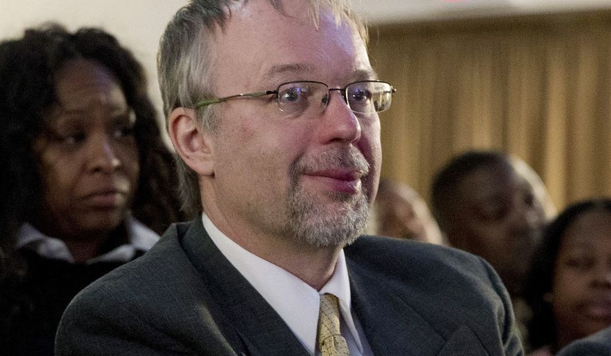 FILE - In this April 17, 2016 file photo, Levi Sanders, son of Democratic presidential candidate Bernie Sanders, I-Vt., listen as Bernie Sanders speaks at the First CorinthiansBaptist Church in New York. Levi Sanders is joining seven fellow New Hampshire Democrats and three Republicans running for the 1st Congressional District seat in 2018. Democratic Rep. Carol Shea-Porter is stepping down after her term ends. (AP Photo/Mary Altaffer, File)