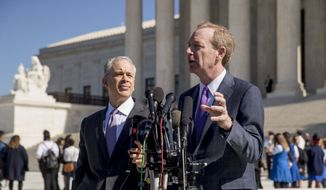 Microsoft President and Chief Legal Officer Brad Smith, right, accompanied by attorney Josh Rosenkranz, left, speaks to reporters outside the Supreme Court, Tuesday, Feb. 27, 2018, in Washington. The Supreme Court heard arguments Tuesday in a dispute between the Trump administration and Microsoft Corp. over a warrant for emails that were sought as part of a drug trafficking investigation.(AP Photo/Andrew Harnik)
