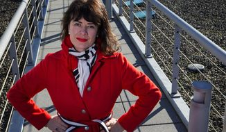 Allison Dvaladze, director, Global Strategy, Partnerships and Advocacy at a Seattle-based international women's cancer project, was sexually assaulted on a Delta flight from Seattle to Amsterdam in 2016 and since then has mounted a one-woman campaign to bring attention to the issue. She is standing on the roof of the building where she works Wednesday, Dec. 6, 2017. (Ellen M. Banner/The Seattle Times via AP)