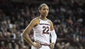 FILE - In this Dec. 17, 2017, file photo, South Carolina forward A'ja Wilson (22) stands on the court during the first half of an NCAA college basketball game against Savannah State, in Columbia, S.C. A'ja Wilson is the Associated Press' Southeastern Conference women's basketball player of the year for a third consecutive season, the all-SEC team announced Tuesday, Feb. 27, 2018. (AP Photo/Sean Rayford, File)