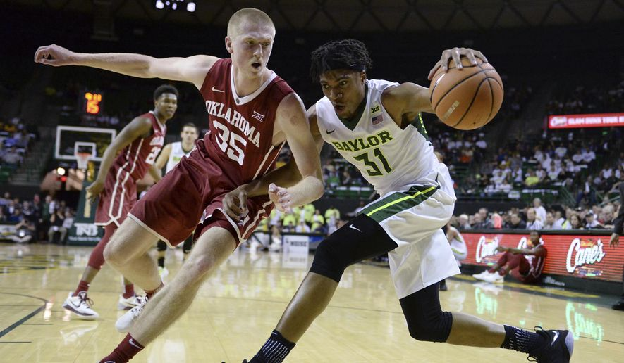 Baylor forward Terry Maston, right, is guarded by Oklahoma forward Brady Manek while driving to the basket during the first half of an NCAA college basketball game Tuesday, Feb. 27, 2018, in Waco, Texas. (Ernesto Garcia/Waco Tribune Herald via AP)
