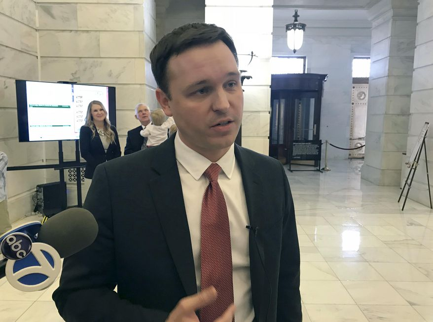 Jared Henderson speaks to reporters at the Arkansas state Capitol in Little Rock, Ark. on Tuesday, Feb. 27, 2018 before filing paperwork to run as a Democrat for governor. (AP Photo/Andrew Demillo)