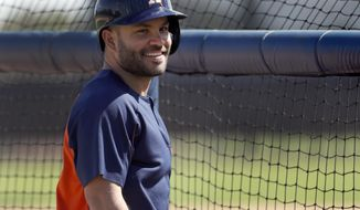 FILE - In this Feb. 19, 2018, file photo, Houston Astros infielder Jose Altuve smiles during spring training baseball practice, in West Palm Beach, Fla. After winning American League MVP last season with another great performance in a stellar young career, many wonder what Jose Altuve will do for an encore.  (AP Photo/Jeff Roberson, File)