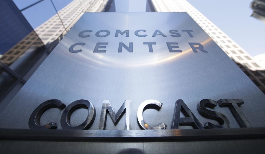 This file photo dated Wednesday, March 29, 2017, shows a sign outside the Comcast Center in Philadelphia. The owner of NBC and Universal Pictures, Comcast launched a bid Tuesday Feb. 27, 2018, for British pay TV broadcaster Sky that threatens to thwart the takeover ambitions of media mogul Rupert Murdoch. (AP Photo/Matt Rourke, File)