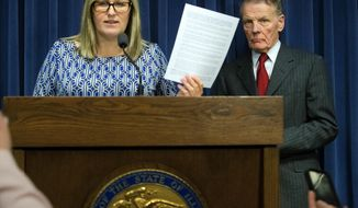 Illinois House Speaker Michael Madigan listens as lawyer Heather Wier Vaught discusses a list of sexual harassment complaints in Springfield, Ill., Tuesday, Feb. 27, 2018. Madigan has released an internal review showing nine incidents of sexual harassment or discrimination in his state office in the past five years and how they were resolved. (Ted Schurter/The State Journal-Register via AP)