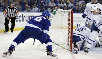 Tampa Bay Lightning center Tyler Johnson (9) wraps the puck into the goal past Toronto Maple Leafs goaltender Frederik Andersen (31) and defenseman Roman Polak (46) during the second period of an NHL hockey game Monday, Feb. 26, 2018, in Tampa, Fla. (AP Photo/Chris O'Meara)