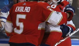 Florida Panthers center Jared McCann, right, celebrates with teammates after his game-winning overtime goal against the Toronto Maple Leafs in an NHL hockey game, Tuesday, Feb. 27, 2018, in Sunrise, Fla. Florida won the game 3-2. (AP Photo/Joe Skipper)