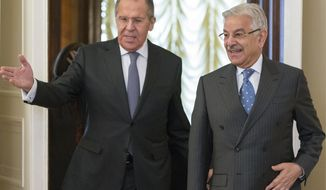 FILE - In this Tuesday, Feb. 20, 2018 file photo, Russian Foreign Minister Lavrov, left, welcomes Pakistan's Foreign Minister Khawaja Muhammad Asif for their talks in Moscow, Russia, Tuesday, Feb. 20, 2018. As Pakistan navigates its troubled relationship with the United States and scrambles to avoid being blacklisted for doing too little, too late to stop terrorist funding, regional alliances are shifting and analysts ponder whether a cozier relationship with countries, like Russia, will complicate efforts to plot a path to peace in Afghanistan and civility between uneasy neighbors.(AP Photo/Alexander Zemlianichenko, File)