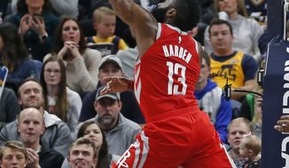 Houston Rockets guard James Harden (13) lays the ball up in the second half during an NBA basketball game against the Utah Jazz Monday, Feb. 26, 2018, in Salt Lake City. (AP Photo/Rick Bowmer)