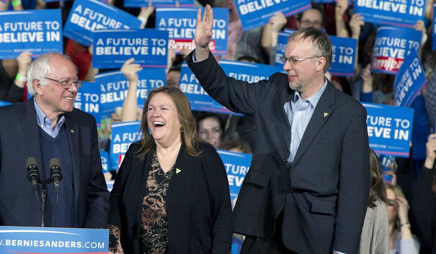 FILE - In this March 1, 2016 file photo, Democratic presidential candidate Sen. Bernie Sanders, I-Vt., his wife Jane Sanders, and his son Levi Sanders arrive at a primary night rally in Essex Junction, Vt. Levi Sanders is joining seven fellow New Hampshire Democrats and three Republicans running for the 1st Congressional District seat in 2018. Democratic Rep. Carol Shea-Porter is stepping down after her term ends.(AP Photo/Jacquelyn Martin, File )