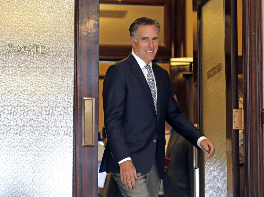 Mitt Romney leaves the Senate offices at the Utah State Capitol Tuesday, Feb. 27, 2018, in Salt Lake City. Romney held closed-door meetings with Utah lawmakers as the former Republican presidential nominee continues his bid to become a prominent new U.S. Senator for Utah. (AP Photo/Rick Bowmer)