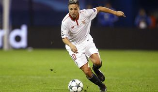 "FILE - In this Tuesday, Oct. 18, 2016 file photo, Sevilla's Samir Nasri controls the ball during their Champions League soccer match against Dinamo Zagreb, at the Maksimir stadium in Zagreb, Croatia. Former France international Samir Nasri has been banned from football for six months for an anti-doping violation from 2016. UEFA says Nasri has been found guilty of using a ""prohibited method"" in violation of the World Anti-Doping Code and UEFA's anti-doping regulations. Disciplinary proceedings were opened in March last year and the decision was taken on Tuesday, Feb. 27, 2018. (AP Photo/Darko Bandic, file)"