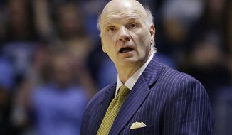 Saint Joseph's head coach Phil Martelli reacts to his team play during the first half of their NCAA college basketball game against Rhode Island at the Ryan Center Tuesday, Feb. 27, 2018, in South Kingstown, R.I. (AP Photo/Stephan Savoia)