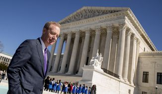 Microsoft President and Chief Legal Officer Brad Smith, left, leaves the Supreme Court, Tuesday, Feb. 27, 2018, in Washington. (AP Photo/Andrew Harnik) ** FILE **