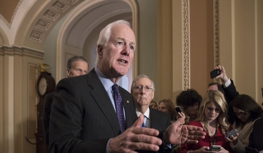 Senate Majority Whip John Cornyn, R-Texas, flanked by Sen. John Thune, R-S.D., left, and Senate Majority Leader Mitch McConnell, R-Ky., talks to reporters following weekly policy luncheons where they discussed school safety measures in response to the Parkland, Fla., shooting, at the Capitol in Washington, Tuesday, Feb. 27, 2018. (AP Photo/J. Scott Applewhite) ** FILE **