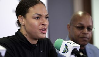 Dallas Wings newly acquired center Liz Cambage, of Australia, responds to a question during a news conference as head coach Fred Williams, right, listens, at College Park Center Monday, Feb. 26, 2018, in Arlington, Texas. (AP Photo/Tony Gutierrez)