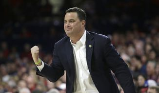 This Saturday, Jan. 27, 2018, file photo shows Arizona head coach Sean Miller in the first half during an NCAA college basketball game against Utah in Tucson, Ariz. (AP Photo/Rick Scuteri) ** FILE **
