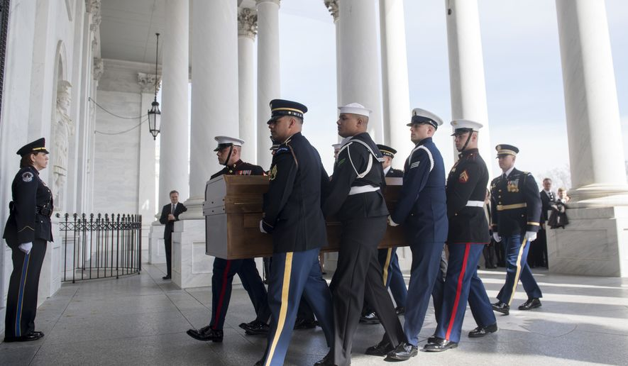 A Military Honor Guard carries the casket of Reverend Billy Graham as it arrives at the US Capitol in Washington, Feb. 28, 2018, prior to a lying in honor ceremony in the Capitol Rotunda. (Saul Loeb/Pool via AP)