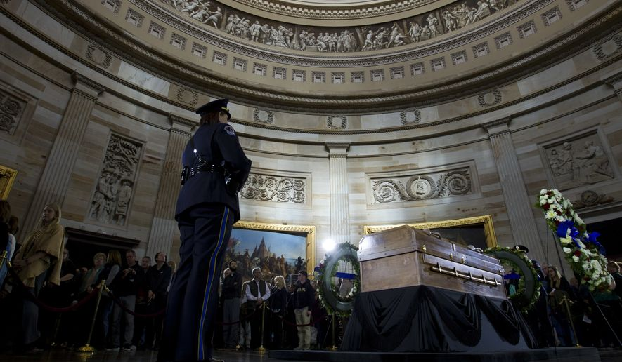 Visitors pay their respects as the casket of Reverend Billy Graham lies in honor at the Rotunda of the U.S. Capitol Building in Washington, Wednesday, Feb. 28, 2018. It's a rare honor for a private citizen to lie in honor at the Capitol. Graham died Wednesday in his sleep at his North Carolina home. He was 99. (AP Photo/Jose Luis Magana)