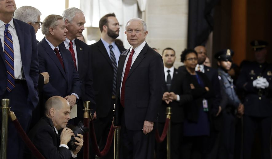 Attorney General Jeff Sessions, center, talks to Sen. Lindsay Graham, R-S.C., and others, as they wait for the ceremony to begin honoring Reverend Billy Graham in the Rotunda of the U.S. Capitol building, Wednesday, Feb. 28, in Washington. (AP Photo/Evan Vucci)