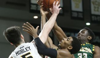 Virginia Commonwealth's Sean Mobley vies for a rebound with George Mason's Justin Kier and Greg Calixte, right, during an NCAA college basketball game, Wednesday, Feb. 28, 2018 in Richmond, Va. (Alexa Welch Edlund/Richmond Times-Dispatch via AP)