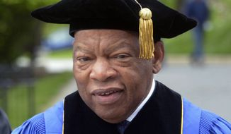 FILE - In this May 13, 2017 file photo, U.S. Rep. John Lewis, D-Ga., walks into commencement exercises at the Massachusetts College of Liberal Arts in North Adams, Mass. Lewis has been named the principal speaker at Harvard University's commencement on May 24, 2018 in Cambridge, Mass., (Gillian Jones/The Berkshire Eagle via AP, File)